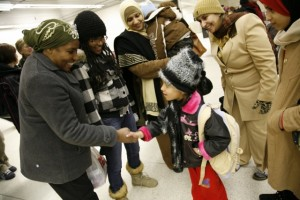 Build A Village, a community group in Altona, Man., provides settlement support for newcomers to Canada. Here, residents welcome a Palestinian family in a Manitoba winter.  MCC photo by Joanie Peters