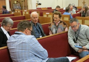 Delegates discuss the kingdom of God after hearing Tim Geddert's keynote address on Friday afternoon.