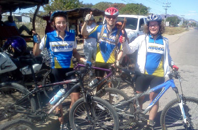 Glencairn MB Church attendees and fellow life group  members Sandra Reimer (r), Trevor Adams, and his daughter Hannah (l) from Kitchener, Ont., embark on a cycling tour of Honduras with Mennonite Central committee. Photo: courtesy Sandra Reimer