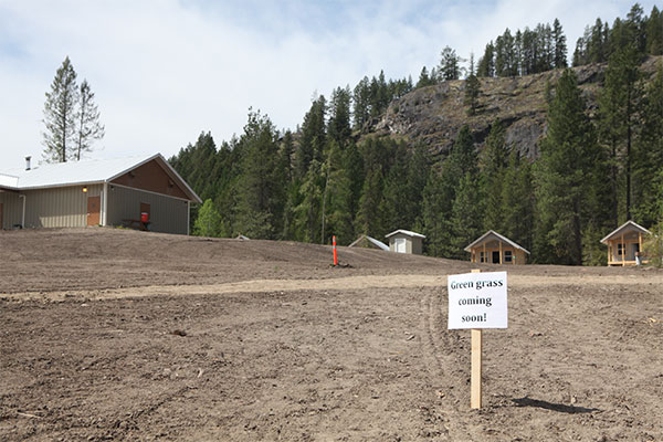 """A sign of hope greets visitors as the Pines camping season nears. It doesn't look like it did before the windstorm, but director Gene Krahn says after all the redesign work, """"it really is beautiful."""""""