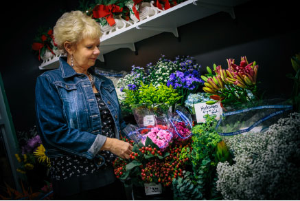 Delores Derksen cares for others by delivering floral arrangements. Photo: Ellaina Brown