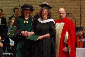 Joan Muehling, who received an MA, is the first student to graduate from the MBBS-CMU partnership.