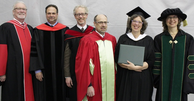 CMU and MBBS staff and faculty surround the first MBBS-CMU MA graduate, Joan Muehling (2nd from l).