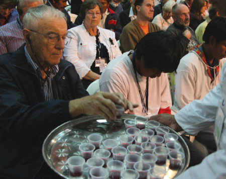 Attendees at Assembly 15 in Paraguay take communion together.  Photo: Lowell Brown