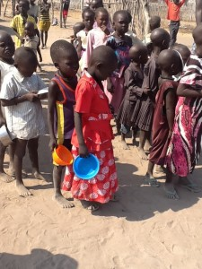 Children wait in line for a food distribution at an Internally Displaced Persons camp in Awerial County carried out by the Sudanese Relief and Development Agency (SUDRA), supported by MCC.   Photo by Simon Mikanipare