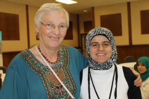 (l-r) Donna Entz, with Mennonite Church Alberta's North Edmonton Ministry, poses with Asia Wehbi who does communications work with Edmonton's Al-Rashid mosque. The two worked together to help organize and publicize the Christian-Muslim dialogue held on Sept. 13. Wehbi worked hard on the website; acwalberta.ca. The website outlines the history and hopes for Christian-Muslim friendship in Alberta and around the world.