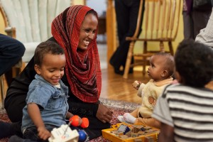 Waeil Abdalla (5 years old), Waleed Abdalla (3 years old), Weam Abdalla (one year old), and Khadija Fikak. Members of Eritrean family sponsored by the Forest Grove Community church, Saskatoon, 2013. Rena Pearson and Idris Fikak.  Forest Grove worked with MCC to sponsor the Fikak family.