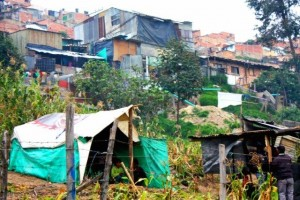 Precarious housing in the neighborhood of El Progresso, Bogota, Colombia. Families displaced by rural conflict began to settle on the slopes of Cazucá, Bogotá, in the 1980s. Credit: Daniel Hernandez