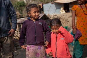 Ashmita Chepang (7), and Ashmika Chepang (4) wearing the jackets they received through MCC partner Sansthagat Bikas Sanjal (Sanjal), in December 2015. The jackets were part of a distribution of winter supplies to about 30 households in the village of Bhasbhase, Nepal, where many homes were destroyed in the April 25th earthquake. Sanjal is an MCC partner in Nepal that operates through a network of local community based organizations. MCC has worked alongside Sanjal in the districts of Surkhet, Dhading, Okhaldunga and Banke districts on a variety of projects, such as HIV/AIDS prevention, food security, rural education, peacebuilding and disaster response.